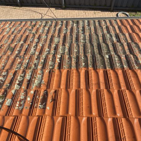 Tile roof cleaning in progress